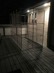 Homemade catio outside at night